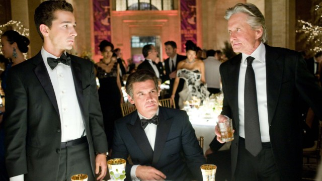 Actors LeBeouf, Brolin and Douglas are shown in a scene from Director Stone's film 'Wall Street 2: Money Never Sleeps' in this undated publicity photograph