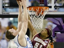 Boston College's Williams blocks shot by University of North Carolina's Hansbrough in Greensboro