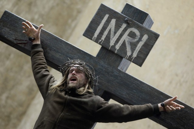 Richter hangs on the cross as he plays the character of Jesus Christ during a rehearsal of 'Passionsspiele' in Oberammergau