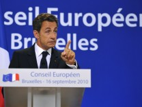 France's President Nicolas Sarkozy speaks at a news conference after an EU leaders summit in Brussels
