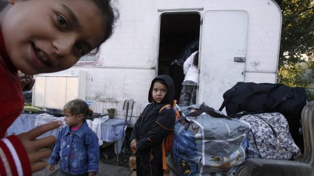 Children of a Roma family prepare to leave a camp to go to Lille Airport for their flight to Romania on a voluntary repatriation scheme