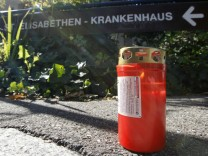 A candle is seen next to the main entrance of the Elisabethen-Krankenhaus hospital in Loerrach