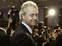Dutch right-wing politician Wilders of  Freedom Party waves to supporter as he arrives to give speech in Berlin