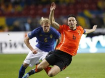 Sweden's Toivonen tackles Netherlands' Van Bommel during their Euro 2012 qualifying soccer match in Amsterdam