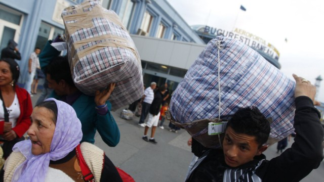 A Roma family arrives at Baneasa international airport in Bucharest from Marseille