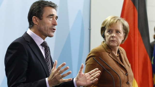 NATO Secretary General Fogh Rasmussen and German Chancellor Merkel address a news conference in Berlin