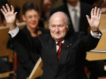 FIFA president Blatter acknowledges applause after being awarded with the honorary membership to the German soccer federation DFB in Essen