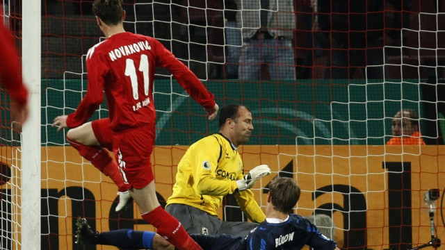 Cologne's Novakovic scores a goal against 1860 Munich the German Soccer Cup match against 1860 Munich in Cologne