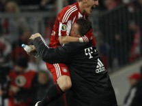 Bayern Munich's Schweinsteiger celebrates with coach van Gaal after scoring against Werder Bremen during German Soccer Cup (DFB-Pokal) match in Munich
