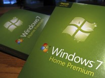 Packages of the new Windows operating system, Windows 7, sit on a desk before being installed in Golden