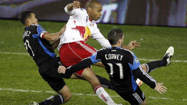 Red Bulls' Henry is tackled Earthquakes' Hernandez and Convey during their MLS Eastern Conference Semi Finals playoff match in Harrison