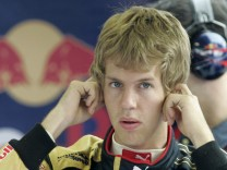 Toro Rosso Formula One driver Vettel of Germany plugs his ears in the pit in Budapest