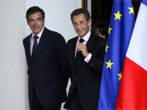 File photo of France's President Sarkozy and Prime Minister Fillon at the Elysee Palace in Paris