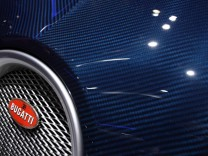 A Bugatti logo is seen on a Veyron car displayed on the exhibition stand of Bugatti during the first media day of the 80th Geneva Car Show