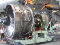 Handout picture of damaged number two engine of a Qantas Airbus A380 in Singapore is removed