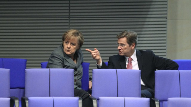 German Chancellor Merkel and Foreign Minister Westerwelle attend Bundestag debate about the federal budget in Berlin