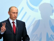 Merkel empfängt Putin