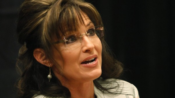 Former Alaska Governor Sarah Palin signs her book during the first stop of her book tour 'American by Heart: Reflections on Family, Faith and Flag' in Phoenix,