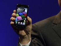 J.K. Shin, president of Mobile Communications Business for Samsung Electronics, unveils a new Galaxy S Android smartphone during the International CTIA Wireless trade show in Las Vegas