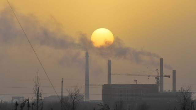 Smoke billows from a power station in Shenyang