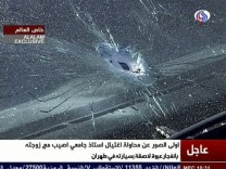 Still image taken from video shows damage to a car following the detonation of a planted bomb in Tehran