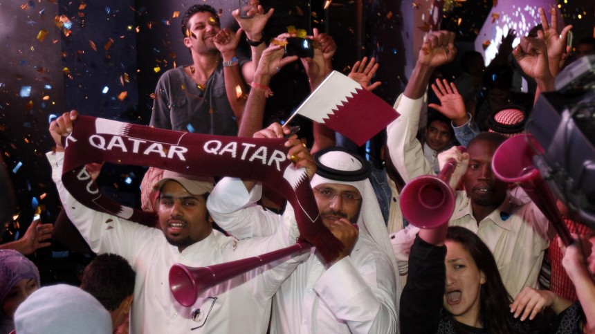 Qatari fans celebrate at Souk Waqif in Doha