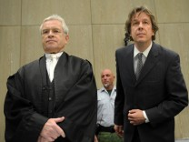 Defendant Swiss meteorologist and TV weather host Kachelmann and new lawyer Schwenn appear at the country court in Mannheim
