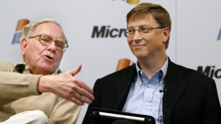File photo of Warren Buffet and Bill Gates speaking during a news conference in Washington