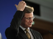 German Foreign Minister Westerwelle gestures during news conference after talks with Cyprus Foreign Minister Kyprianou in Berlin