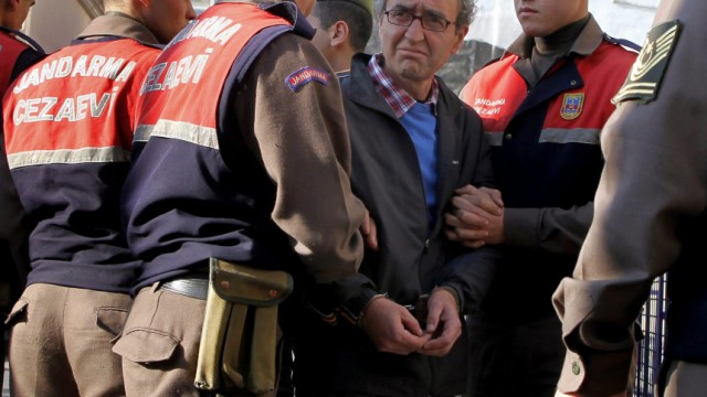 Dogan Akhanli is escorted to court