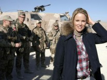 Stephanie zu Guttenberg, wife of German Defence Minister Karl-Theodor zu Guttenberg, stands next to German Bundeswehr army soldiers in Kunduz