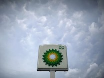 File photo of storm clouds forming near a BP station in Alexandria, Virginia