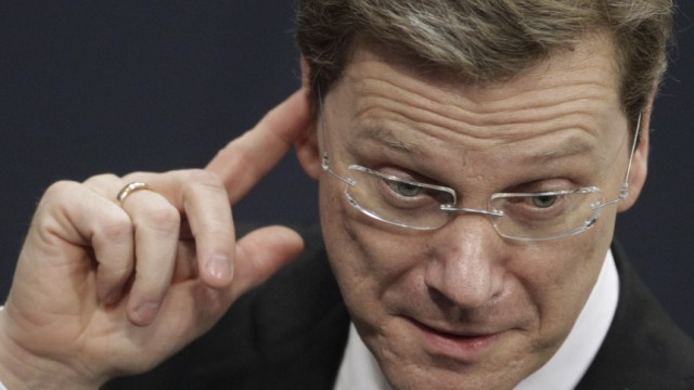 German Foreign Minister Westerwelle gestures before delivering government statement on Germany's engagement in Afghanistan to the lower house of parliament in Berlin