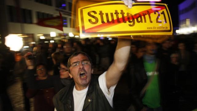 Demonstrators protest in front of the Liederhalle in Stuttgart, where Deutsche Bahn CEO Grube is attending a panel discussion on the Stuttgart 21 underground railway station