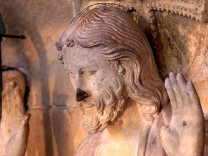 ANTI-PIGEON ELECTRODES SEEN ON STATUE OF JESUS AT NOTRE-DAME