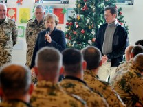 Chancellor Merkel Visits ISAF Soldier Camp In Kunduz