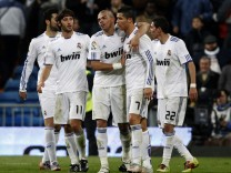 Real Madrid players celebrate after their Spanish first division soccer match against Sevilla at Santiago Bernabeu stadium in Madrid