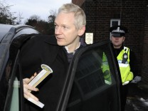 WikiLeaks founder Julian Assange gets into his car outside Beccles police station in Suffolk