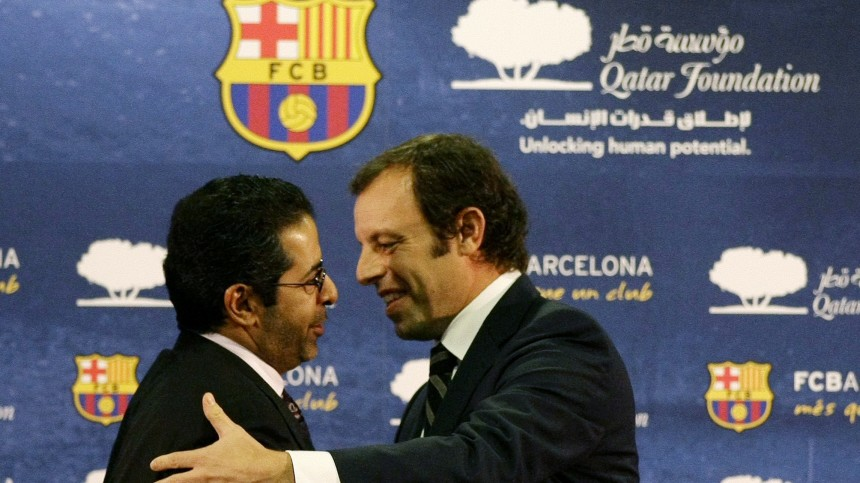 Barcelona's President Rosell embraces CEO of Qatar Sports Investment Ahmed Al-Sulaiti after signing a sponsorship contract with the Qatar Foundation in Barcelona