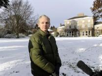 WikiLeaks founder Julian Assange speaks to the media outside Ellingham Hall in Norfolk England