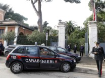 Carabinieris stand at the entrance of the Swiss embassy downtown in Rome