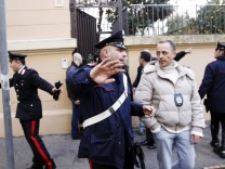 Police work at the scene of an explosion at the Chilean embassy in Rome