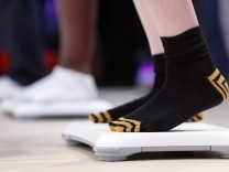 Visitors step on Nintendo Wii Balance Boards as they play the new Wii Fit Plus game during the Electronic Entertainment Expo or E3 in Los Angeles