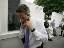 U.S. Treasury Secretary Geithner walks at the White House in Washington