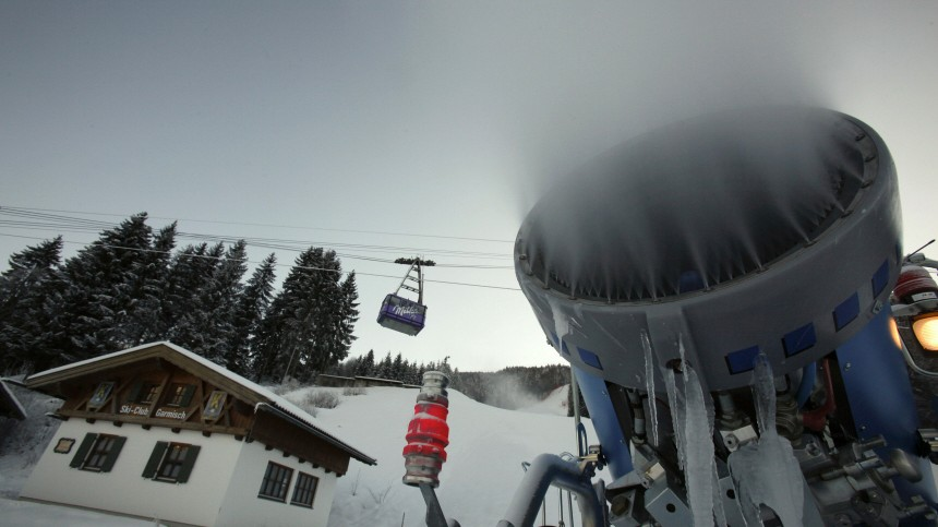 A snow cannon produces artificial snow in the finish area of the 'Kandahar' racing course for Alpine Skiing World Championships in Garmisch-Partenkirchen