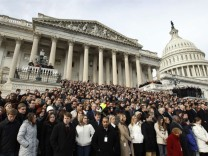 Members of Congress and other Capitol Hill staffers observe a moment of silence on the steps of the U.S. Capitol for Arizona Congresswoman Giffords in Washington