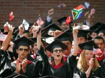 Graduates from the business school celebrate during their commencement at Harvard University in Cambridge