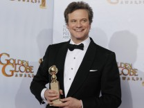 Actor Colin Firth poses with his award for Best Performance by an Actor in a Motion Picture - Drama  for his role in  'The King's Speech' at the 68th annual Golden Globe Awards in Beverly Hills