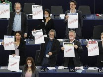 Members of the Greens group of the European Parliament hold posters with word 'Censored' and the names of Hungarian newspapers during the statement of Hungarian Prime Minister Orban at the European Parliament in Strasbourg