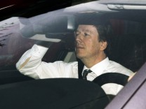 Swiss meteorologist and TV weather host Kachelmann sits in a car as he arrives at the country court in Mannheim